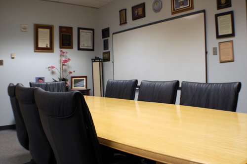 A photograph overlooking the conference table.
